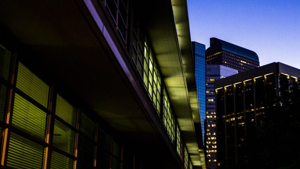 Illuminated buildings downtown at dawn, Sept. 18, 2019. (Kevin J. Beaty/Denverite)