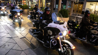 Denver Police officers cruise the 16th Street Mall on motorcycles at dawn. Sept. 18, 2019. (Kevin J. Beaty/Denverite)