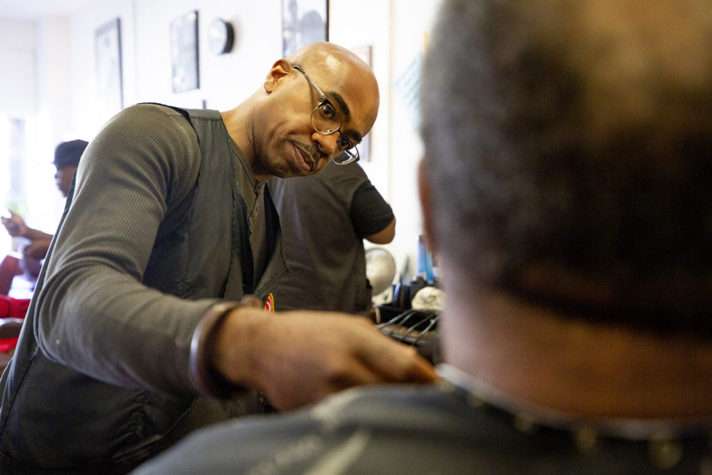 Herman Muhammad at work at his Supreme Style Barbershop on East Colfax Avenue, Sept. 25, 2019. (Kevin J. Beaty/Denverite)