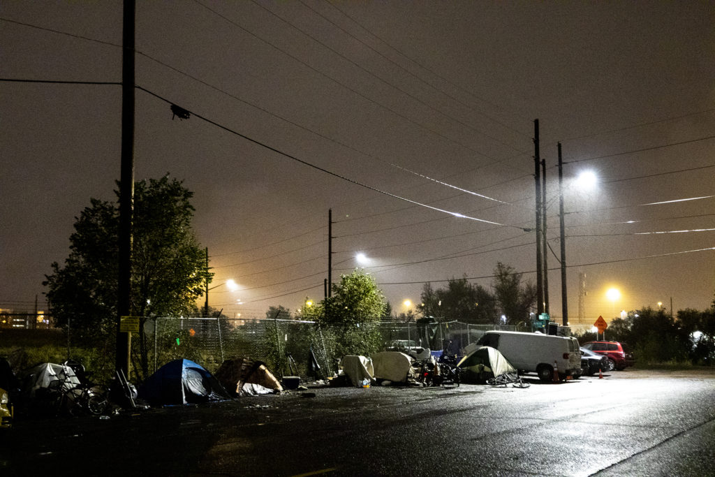 An emcampment across the street from the Salvation Army's Crossroad men's shelter a block off from Brighton Boulevard, Oct. 1, 2019. (Kevin J. Beaty/Denverite)