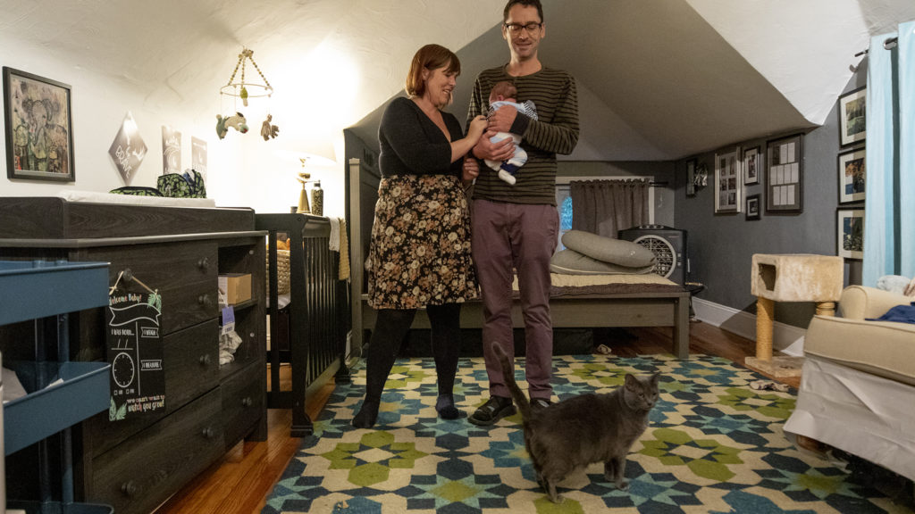 Sarah Wells, Stephen Polk and their son, Charlie, inside their  Capitol Hill home on Oct. 1, 2019. (Kevin J. Beaty/Denverite)