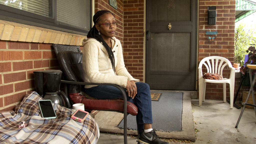 Qaedah Perron, the mother of an 11-year-old who was involved in an incident on a Denver Public Schools bus, speaks to a reporter on her front porch. Oct. 1, 2019. (Kevin J. Beaty/Denverite)