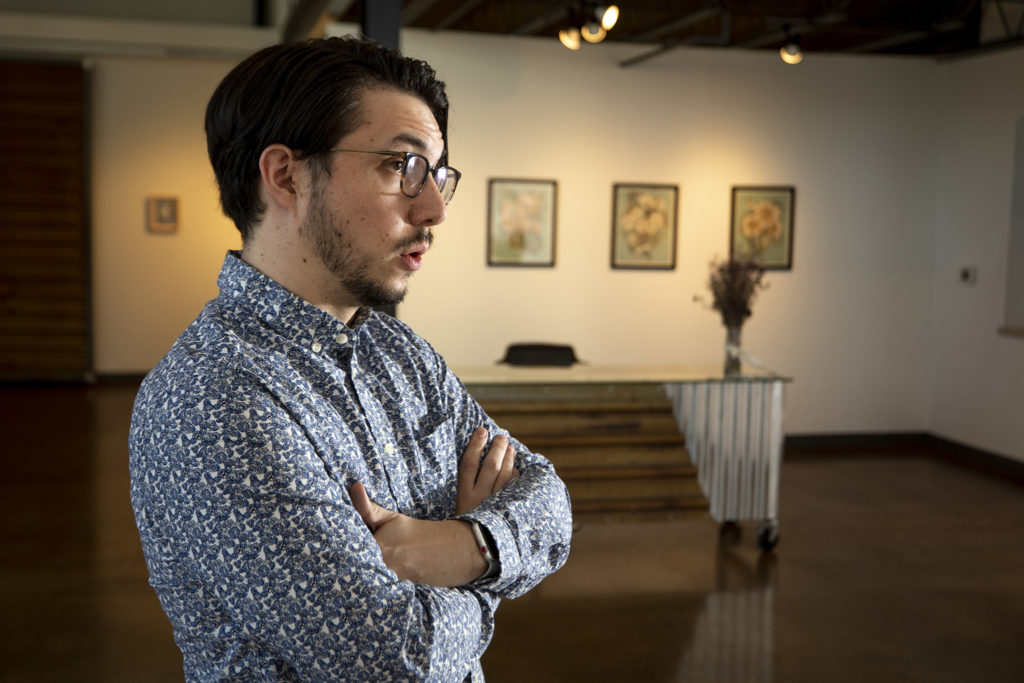 Cayce Goldberg, gallery director of Helikon Gallery and Studios, speaks to a reporter in his space on Wynkoop Street. Five Points, Oct. 2, 2019. (Kevin J. Beaty/Denverite)