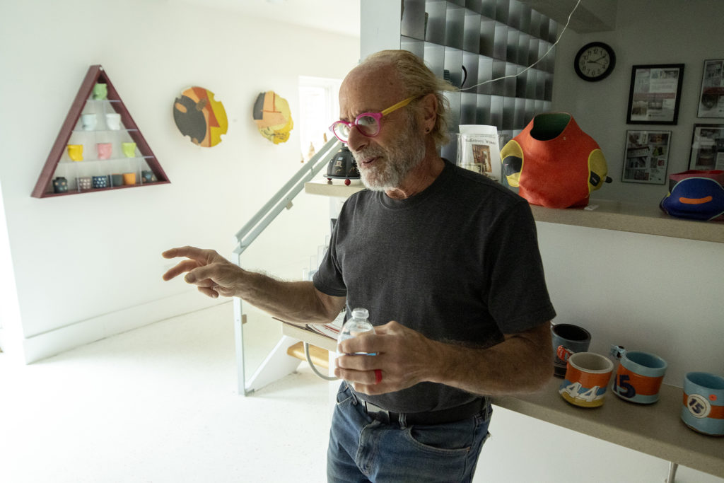 Jonathan Kaplan owner of Plinth Gallery, speaks to a reporter in his space on Brighton Boulevard. Five Points, Oct. 2, 2019. (Kevin J. Beaty/Denverite)