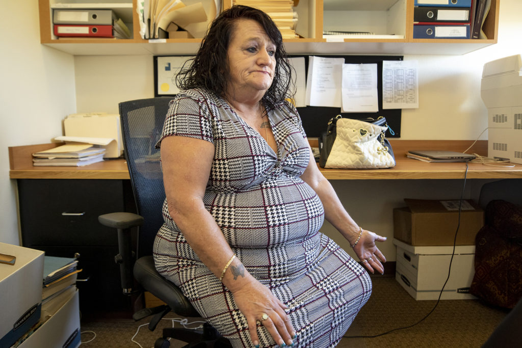 Beth Lawler Stichter speaks to a reporter inside the medical-legal practice office at the Salud Family Health Center in Commerce City. Oct. 2, 2019. (Kevin J. Beaty/Denverite)