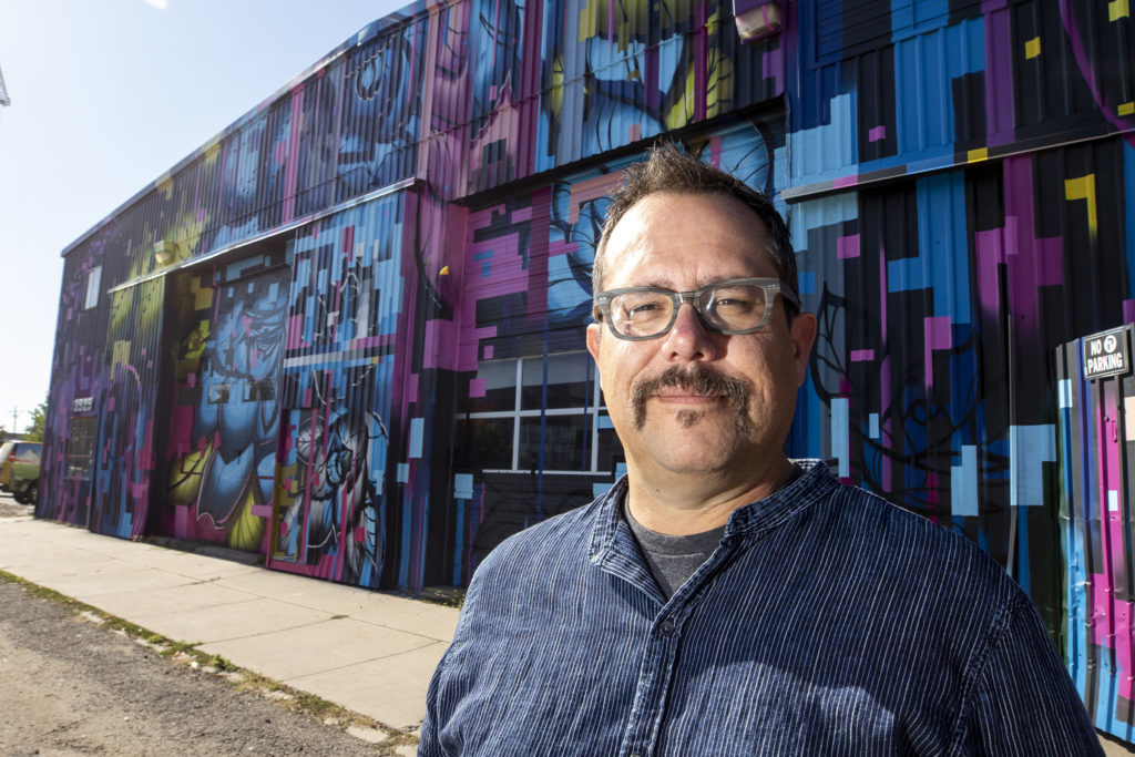 Tracy Weil, president and co-founder of the RiNo Art District, poses for a portrait outside of his office on Walnut Street in Five Points, Oct. 2, 2019. (Kevin J. Beaty/Denverite)