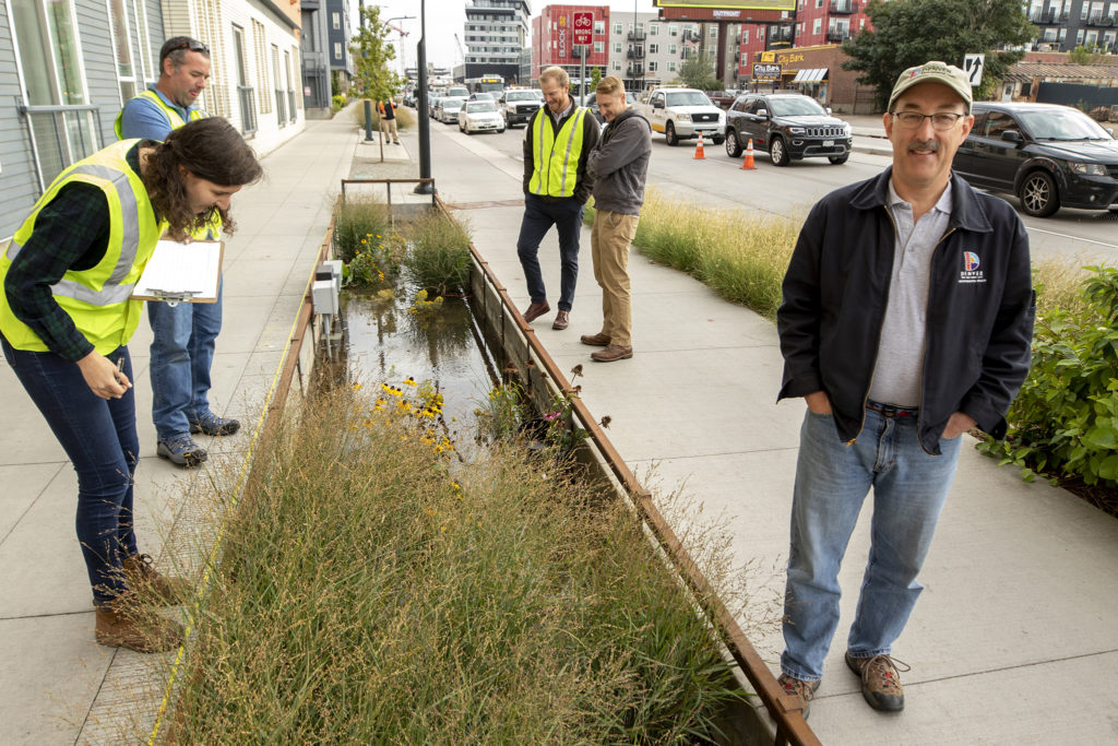 Denver Department of Public Heath and Envirionment water quality expert Jon Novick poses for a portrait. Consultants and city workers fill a green infrastructure impoundment along Brighton Boulevard to test its effecacy, Oct. 3, 2019. (Kevin J. Beaty/Denverite)