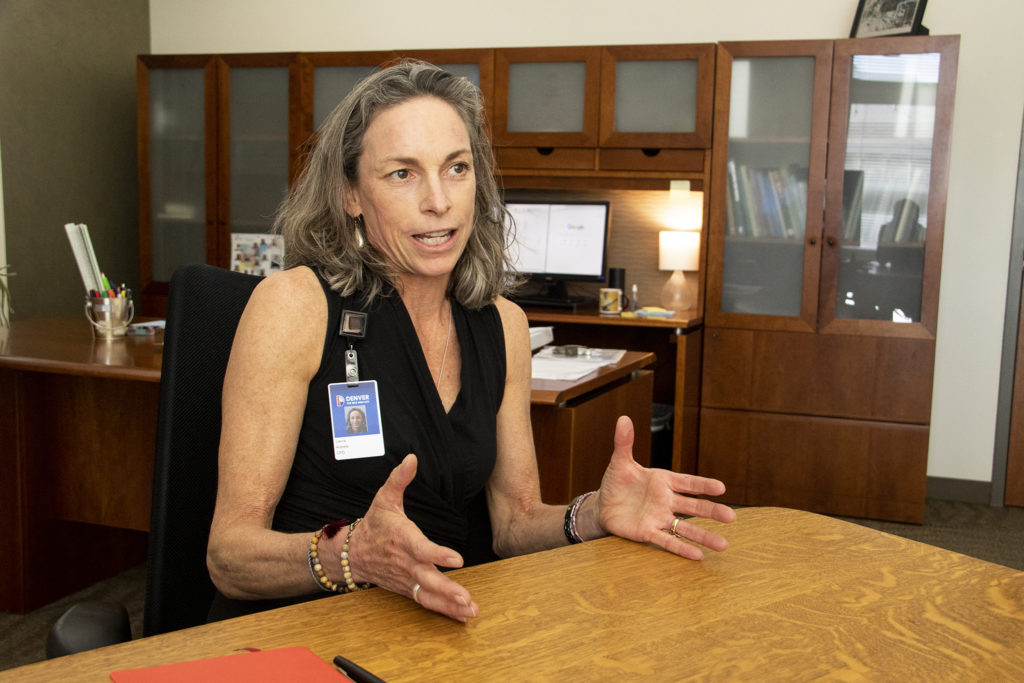 Laura Aldrete, the new head of Denver's Department of Community Planning and Development, speaks to a reporter in her office. Oct. 15, 2019. (Kevin J. Beaty/Denverite)