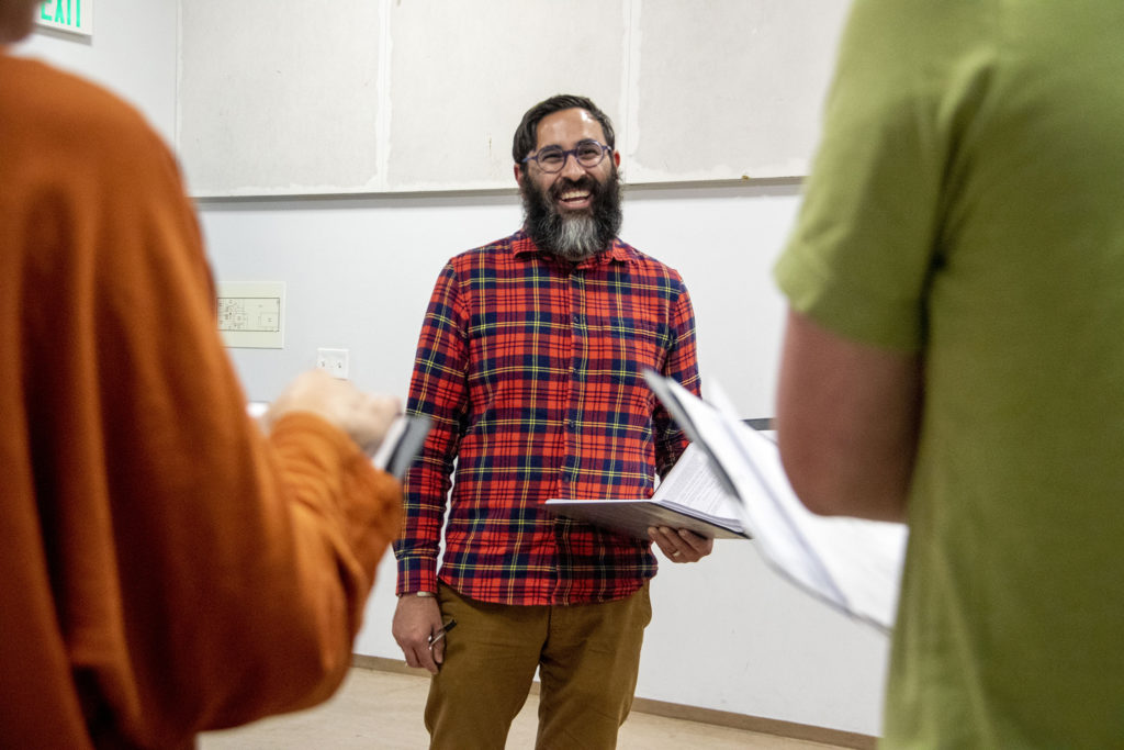"""""""My Country, My Country"""" director Manuel Aragon workshops the play with the cast at the Robert and Judi Newman Center for Theater Education at the Denver Center for the Performing Arts, Oct. 16, 2019. (Kevin J. Beaty/Denverite)"""