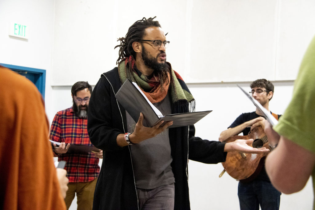 """Stephen Brackett workshops lines with playwright Brenton Weyi and the rest of the cast on """"My Country, My Country"""" at the Robert and Judi Newman Center for Theater Education at the Denver Center for the Performing Arts, Oct. 16, 2019. (Kevin J. Beaty/Denverite)"""