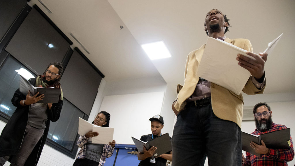 """Playwright Brenton Weyi (second from right) workshops his play, """"My Country, My Country,"""" with his cast at the Robert and Judi Newman Center for Theater Education at the Denver Center for the Performing Arts, Oct. 16, 2019. (Kevin J. Beaty/Denverite)"""