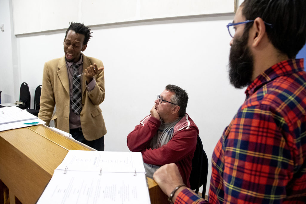 """""""My Country, My Country"""" playwright Brenton Weyi (left to right), musical director David Nehls and director Manuel Aragon workshop the play at the Robert and Judi Newman Center for Theater Education at the Denver Center for the Performing Arts, Oct. 16, 2019. (Kevin J. Beaty/Denverite)"""