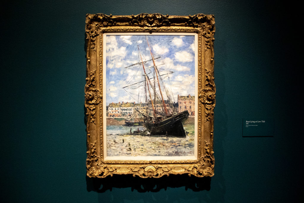 """""""Boat Lying at Low Tide"""" on display in the Denver Art Museum's """"Claude Monet: The Truth of Nature"""" exhibit Oct. 17, 2019. (Kevin J. Beaty/Denverite)"""