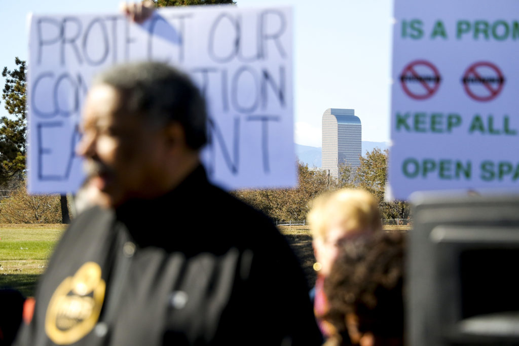 Former Denver Mayor Wellington Webb speaks at a rally on the edge of Park Hill Golf Course demanding the space not be redeveloped. Oct. 22, 2019. (Kevin J. Beaty/Denverite)