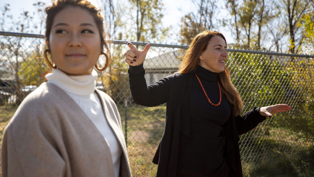 Jen Kim (left) and Slavica Park descibe their vision for Huerta, the social enterprise that will one day occupy the space here behind Focus Points in Elyria Swansea. Oct. 23, 2019. (Kevin J. Beaty/Denverite)