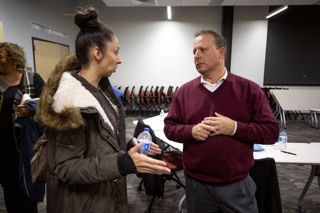 City Councilwoman Candi CdeBaca speaks to Greg Mauro, head of Denver's Division of Community Corrections, after the Community Corrections Advisory Committee met at the Carla Madison Recreation Center on Colfax Avenue, Oct. 24, 2019. (Kevin J. Beaty/Denverite)