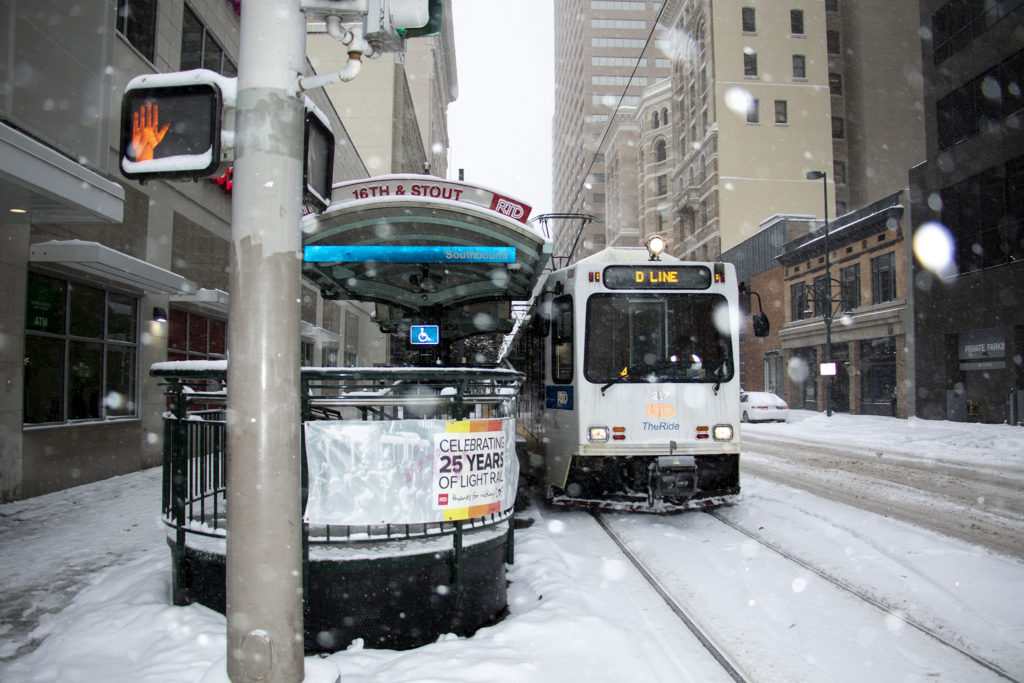 And RTD train downtown on a snowy day in Denver. Oct. 29, 2019. (Kevin J. Beaty/Denverite)