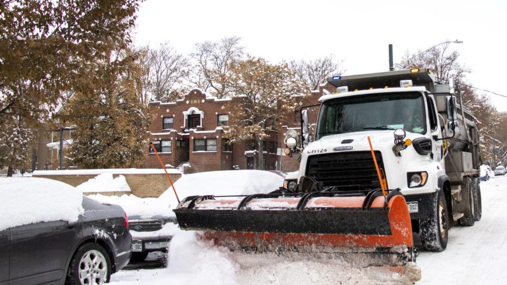 A Denver Public Works snowplow on the job in Capitol Hill, Oct. 29, 2019. (Kevin J. Beaty/Denverite)