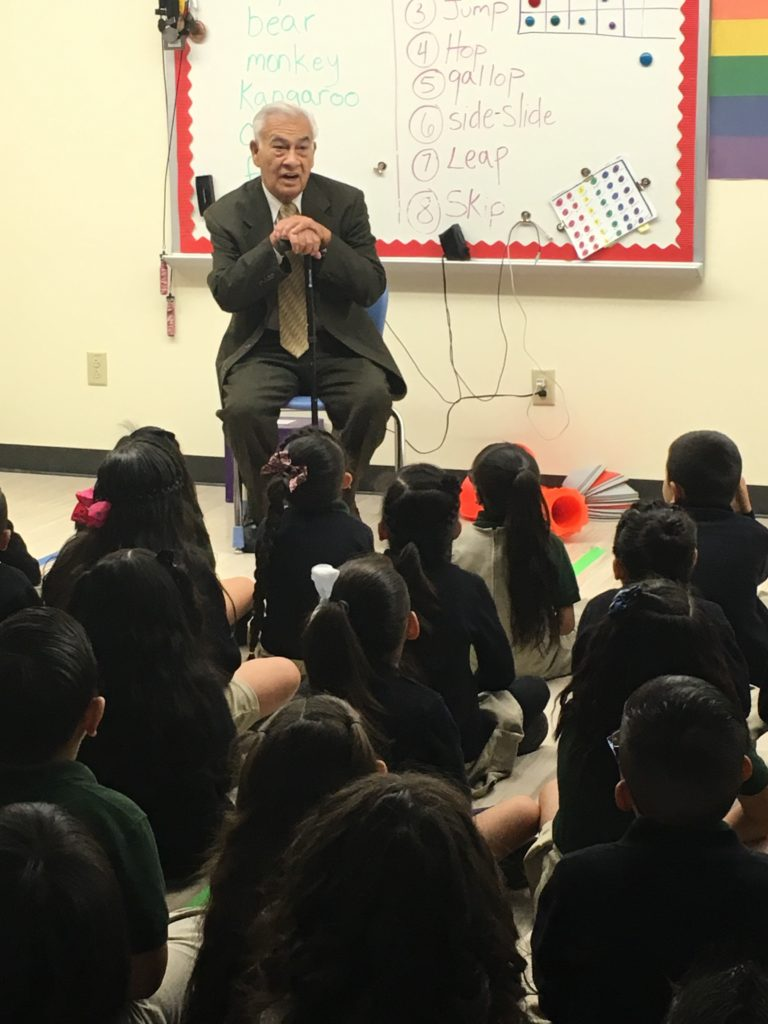 Ruben Valdez speaks to first grade students at STRIVE-Ruby Hill Elementary School, which is located on the campus named after Valdez. Courtesy of the Valdez family.