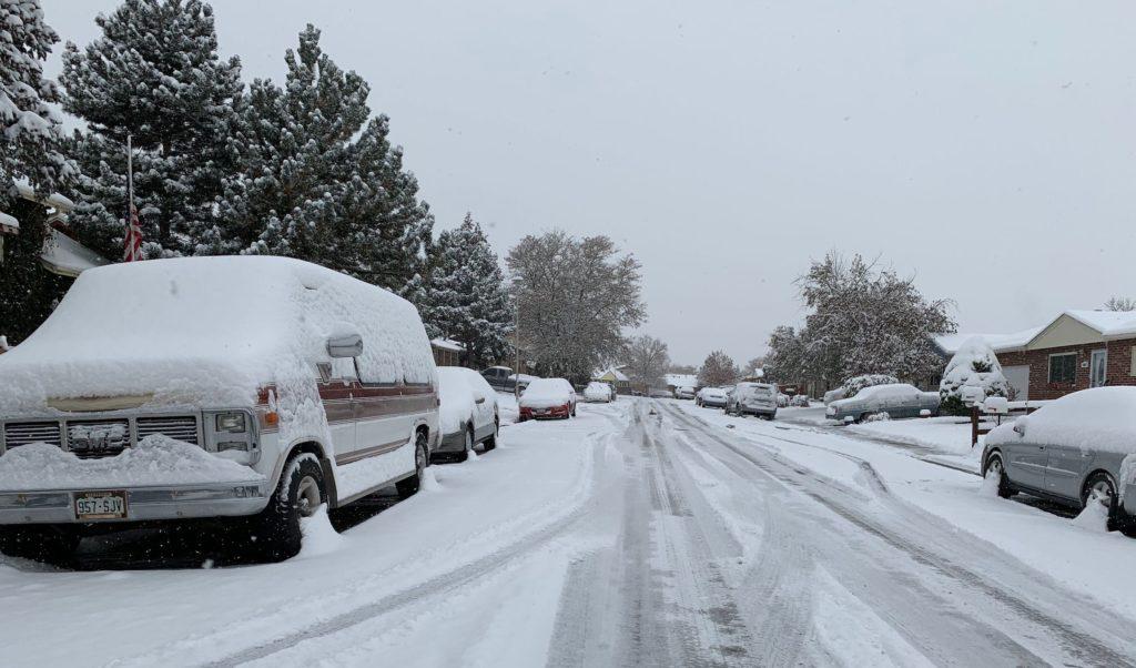 Parked cars along a residential street in Montbello on Monday, Oct. 28, in northeast Denver. (Esteban L. Hernandez/Denverite)