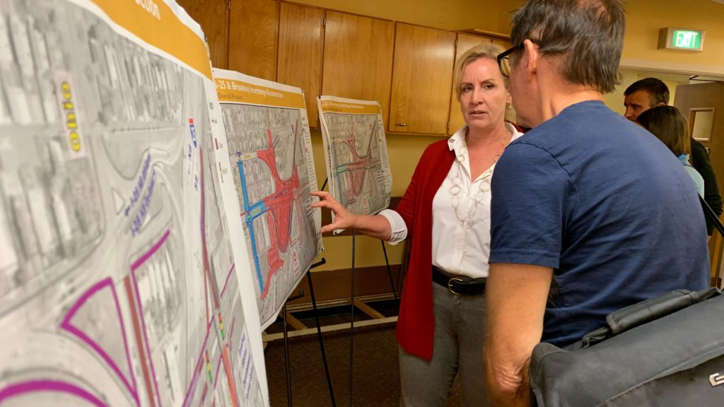 Deb Turner, engineering supervisor with Denver Public Works, speaks to a man before the start of a project meeting on Monday, Oct. 7, 2019, at Epiphany Lutheran Church in Denver. (Esteban L. Hernandez/Denverite)