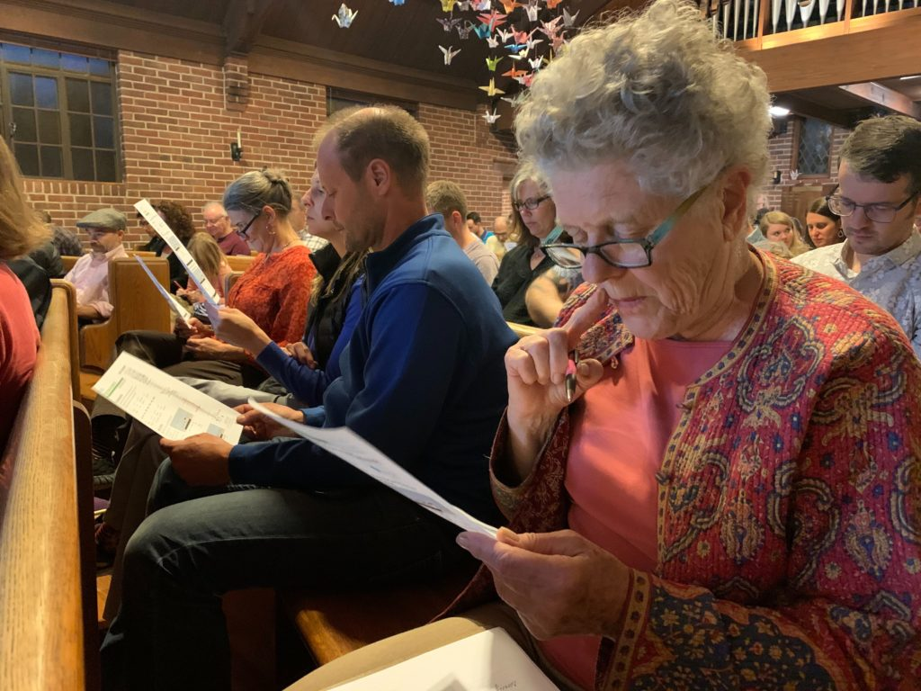 Lincoln Street resident Gertie Grant looks over potential options for the street's redesign during a meeting on Monday, Oct. 14, at Epiphany Lutheran Church in Denver. (Esteban L. Hernandez/Denver)