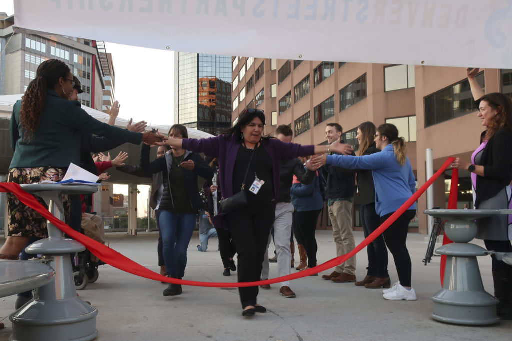District C RTD Director Angie Rivera-Malpiede crosses the finish line last at the transportation race on Oct. 3, 2019. (Nathaniel Minor/CPR News)