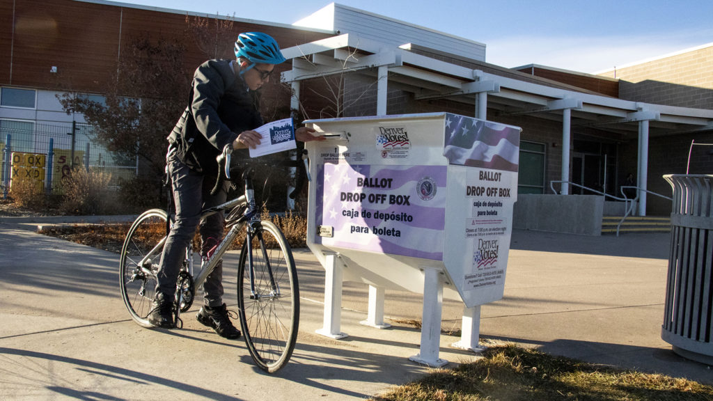 Anders O'Toole drops off a ballot at the Central Park Recreation Center on Election Day, Nov. 5, 2019. (Kevin J. Beaty/Denverite)