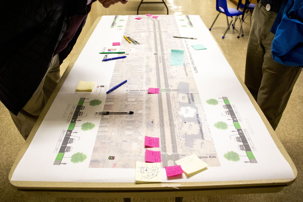A blueprint of a possible bike lane design on South Marion Parkway displayed during a public meeting at Steele Elementary School, Nov. 7, 2019. (Kevin J. Beaty/Denverite)