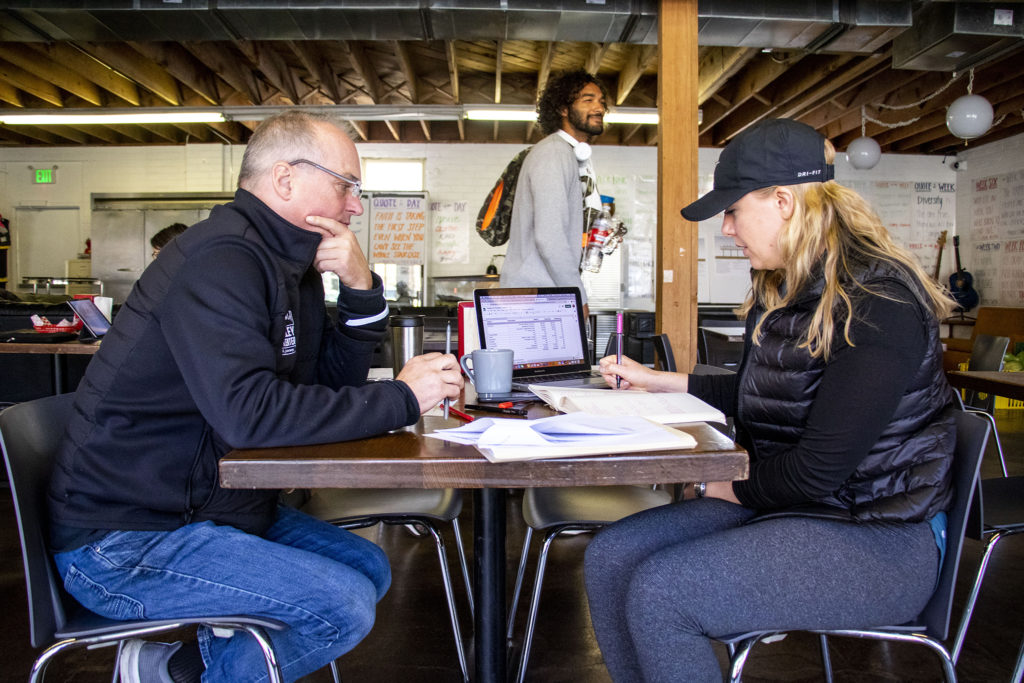 Glenn Harper and Daisy Wiberg, who run the Sun Valley Kitchen, work in their space on Decatur Street. Nov. 7, 2019. (Kevin J. Beaty/Denverite)