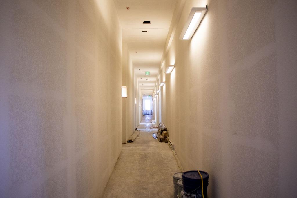 An unfinished hallway inside a new housing project at Laradon in Globeville. Nov. 8, 2019. (Kevin J. Beaty/Denverite)