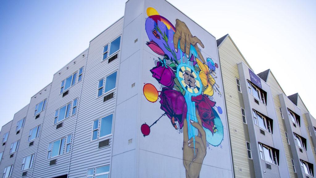 A mural by Jolt on a new housing project at Laradon in Globeville. Nov. 8, 2019. (Kevin J. Beaty/Denverite)