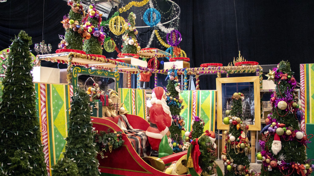 """This is """"Santa Land. """" Lonnie Hanzon's """"Camp Christmas"""" is under construction at Stanley Marketplace. Nov. 15, 2019. (Kevin J. Beaty/Denverite)"""