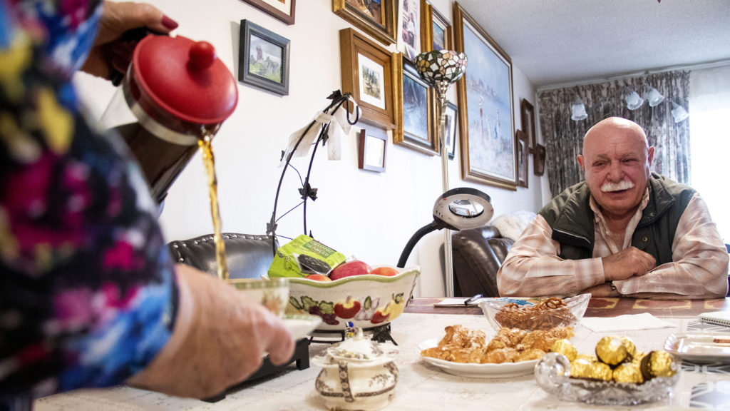Alla Sheherbi pours tea for her husband, Simon Kaganov, in their home at Windsor Gardens, Nov. 16, 2019. (Kevin J. Beaty/Denverite)