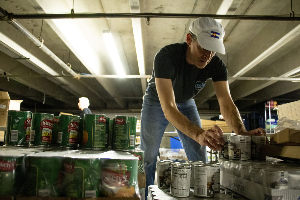 Justin Levy packs Thanksgiving meal kits inside Jewish Family Services' food pantry, Nov. 19, 2019. (Kevin J. Beaty/Denverite)