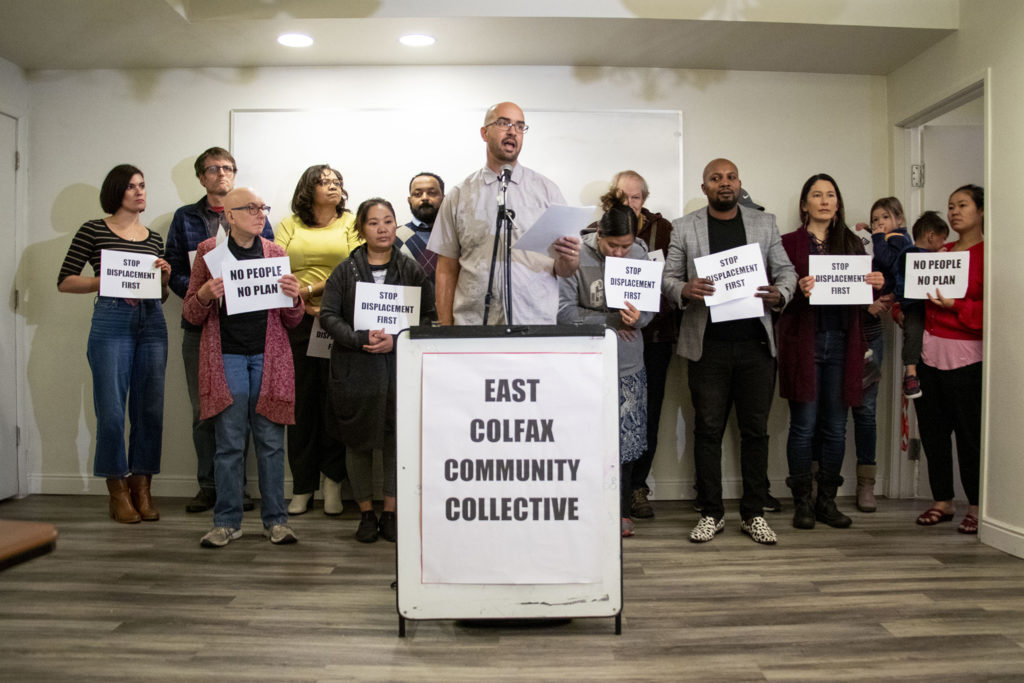 Brendan Greene opens a press conference for the East Colfax Community Collective as they announce their inception. The Hidden Brook Apartments, Nov. 21, 2019. (Kevin J. Beaty/Denverite)