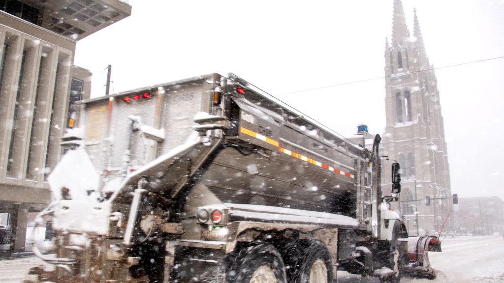 A snow plow barrels down Colfax Avenue, Nov. 26, 2019. (Kevin J. Beaty/Denverite)