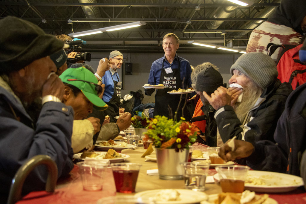 Former Gov. John Hickenlooper serves meals during a Thanksgiving feast at the Denver Rescue Mission, Nov. 27, 2019. (Kevin J. Beaty/Denverite)