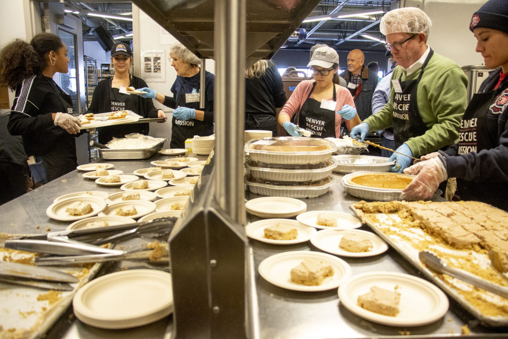 Volunteers prepare dessert during a Thanksgiving feast at the Denver Rescue Mission, Nov. 27, 2019. (Kevin J. Beaty/Denverite)