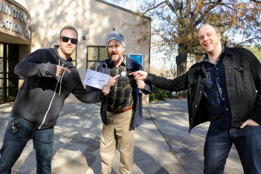 Lukas Vial (left to,right), Ryan Garrett and Mark Cawthray cast their ballots in Washington Park. Nov. 5, 2019. (Kevin J. Beaty/Denverite)