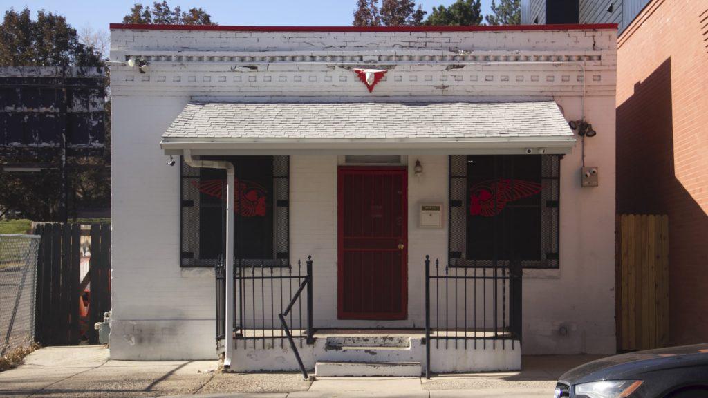 A house on Navajo Street near 33rd Avenue where a neighbor said authorties were heard and seen executing search warrants on Thursday, Nov. 7, 2019, in Denver. (Esteban L. Hernandez/Denverite)