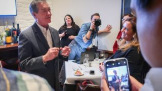 Former Gov. Bill Owens speaks to opponents of Proposition CC at a restaurant in Denver on Tuesday, Nov. 5, 2019. (Nathaniel Minor/CPR News)