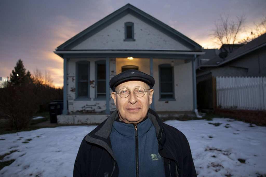 Joel Judd poses for a portrait in front of his home in Jefferson Park, Dec. 12, 2019. (Kevin J. Beaty/Denverite)
