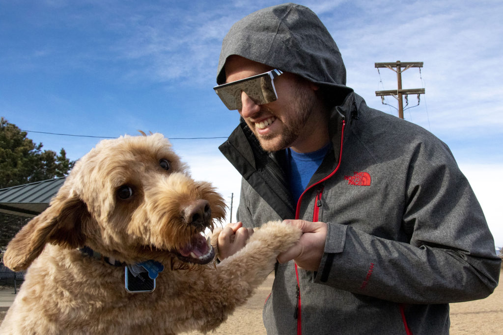 Bruno and his human, Damon Crumpley, pose for a portrait on a Friday morning at the Berkeley Dog Park. Dec. 13, 2019. (Kevin J. Beaty/Denverite)