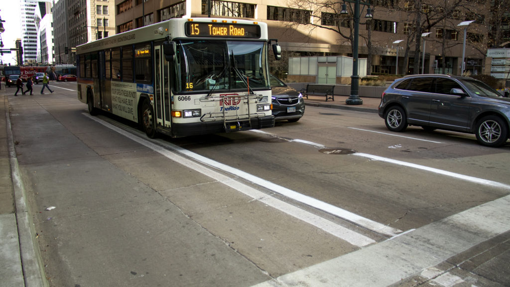 An RTD bus drives down a freshly-painted bus lane on 17th Avenue downtown. Dec. 13, 2019. (Kevin J. Beaty/Denverite)