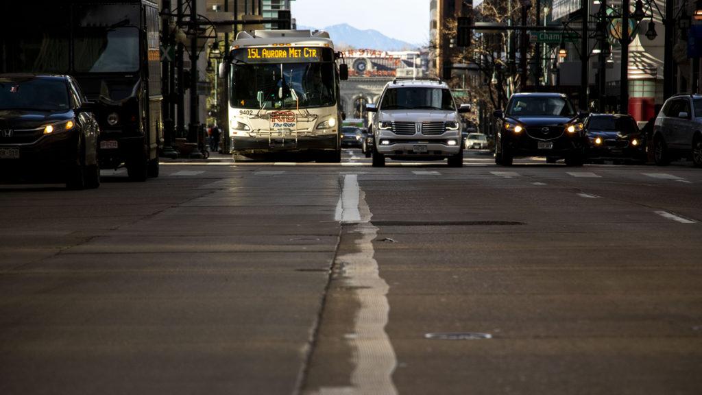 An RTD bus drives down a freshly-painted bus lane on 17th Street downtown. Dec. 13, 2019. (Kevin J. Beaty/Denverite)