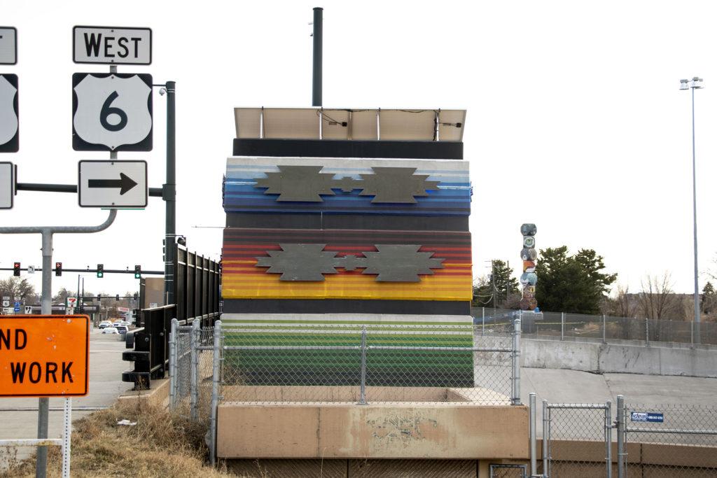 "Anthony Garcia's ""Crossroads/Encrucijada"" and Jaime Molina's ""La Veleta/The Weathervane"" seen from Federal Boulevard. Dec. 14, 2019. (Kevin J. Beaty/Denverite)"