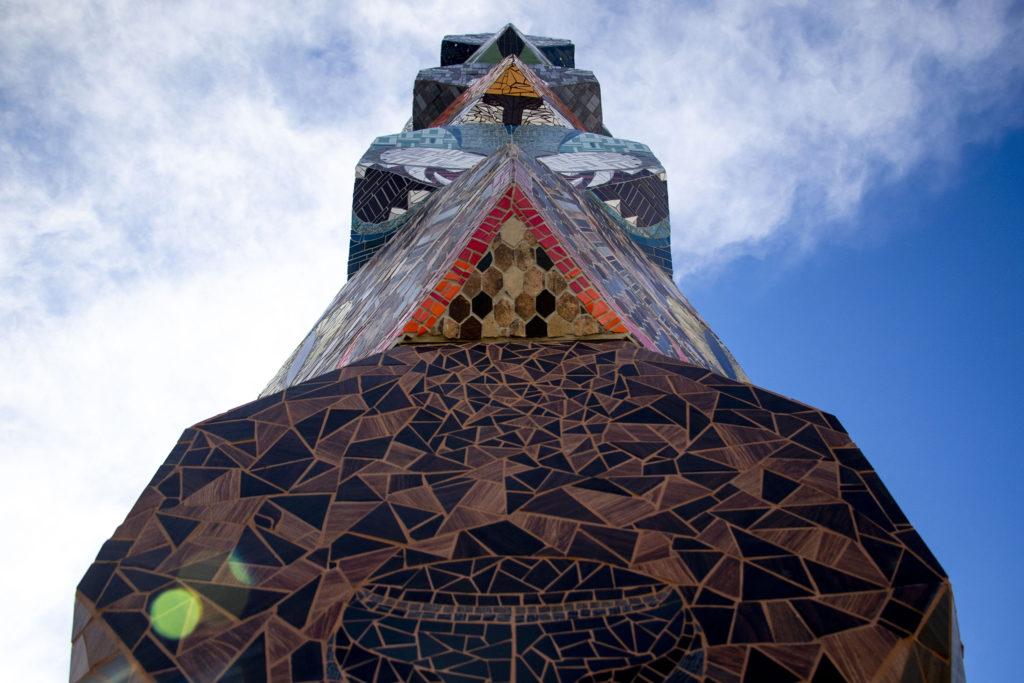 "Jaime Molina's ""La Veleta/The Weathervane"" towers above Federal Boulevard from its new home at Barnum Park. Dec. 14, 2019. (Kevin J. Beaty/Denverite)"