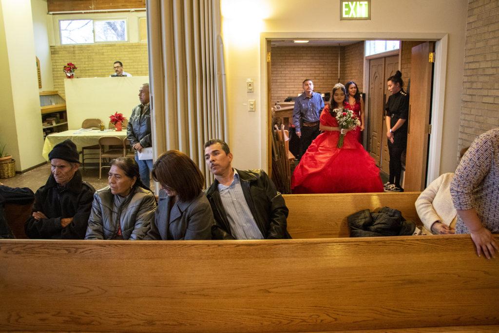 Kim Ramos makes an entrace for her quinceañera ceremony at Ministerio Hispano Presbyterian Church, Dec 14, 2019. (Kevin J. Beaty/Denverite)