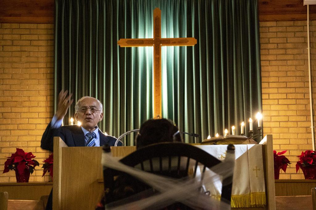 Pastor Rafael Ballares gives a sermon in Spanish during Kim Ramos' quinceañera ceremony at Ministerio Hispano Presbyterian Church, Dec 14, 2019. (Kevin J. Beaty/Denverite)